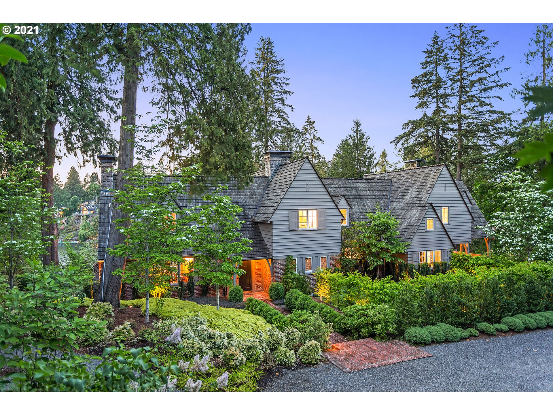 Beautiful Sundeleaf home remastered w modern sophistication. Quiet hillside location w/ views of Oswego Lake. Perfect blend of vintage details & luxe style. Spacious gmt kit w/ high-end appls, lg island. Priv mstr ste w/ spa-like en suite. Incred orig woodwork & unique architectural details thru-out. Multi living areas. Fitness rm. Storage galore. Outdr entertaining in gardens, bocce court, terraces, patios & fire pit. New Guesthouse & cantilever glass garage. Lake easement & boat slip.