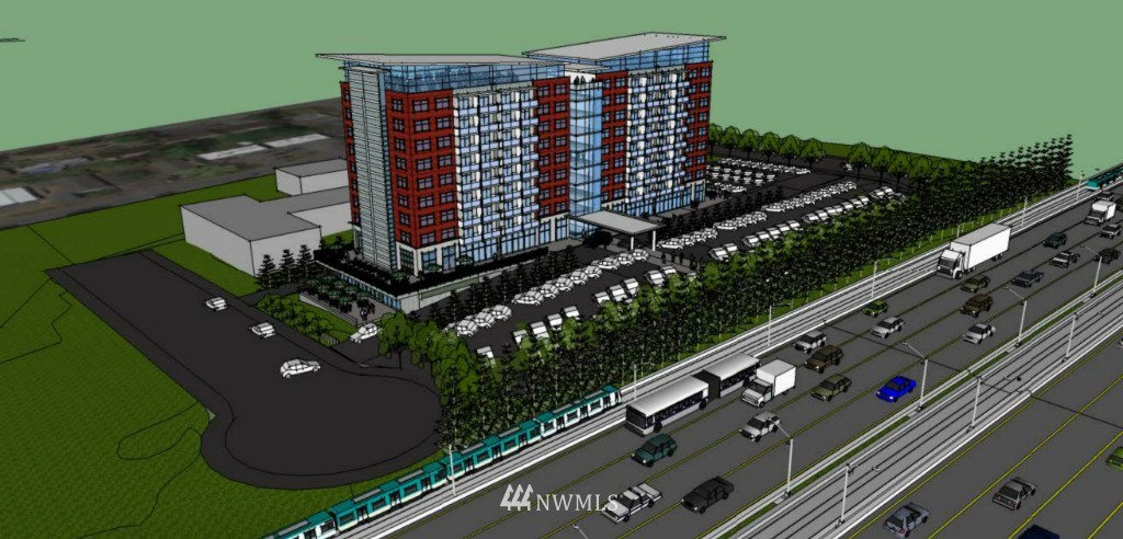 High visibility, level, multi-family or hotel site w/SEPA, EB 5 eligible, with 395' of I-5 frontage & 206,000 vehicles per day traffic count. Contact LA for Feasibility Study for 250 DU MF, 257 DU Hotel, or combo MF/Hotel project.  Property is fully serviced, has 8-year Multi-Family property tax exemption, and offers spectacular sound and mountain views above parking levels in all directions.  4 blocks from new 4-star Artemis Hotel. City promises quick permits and reduced fees.