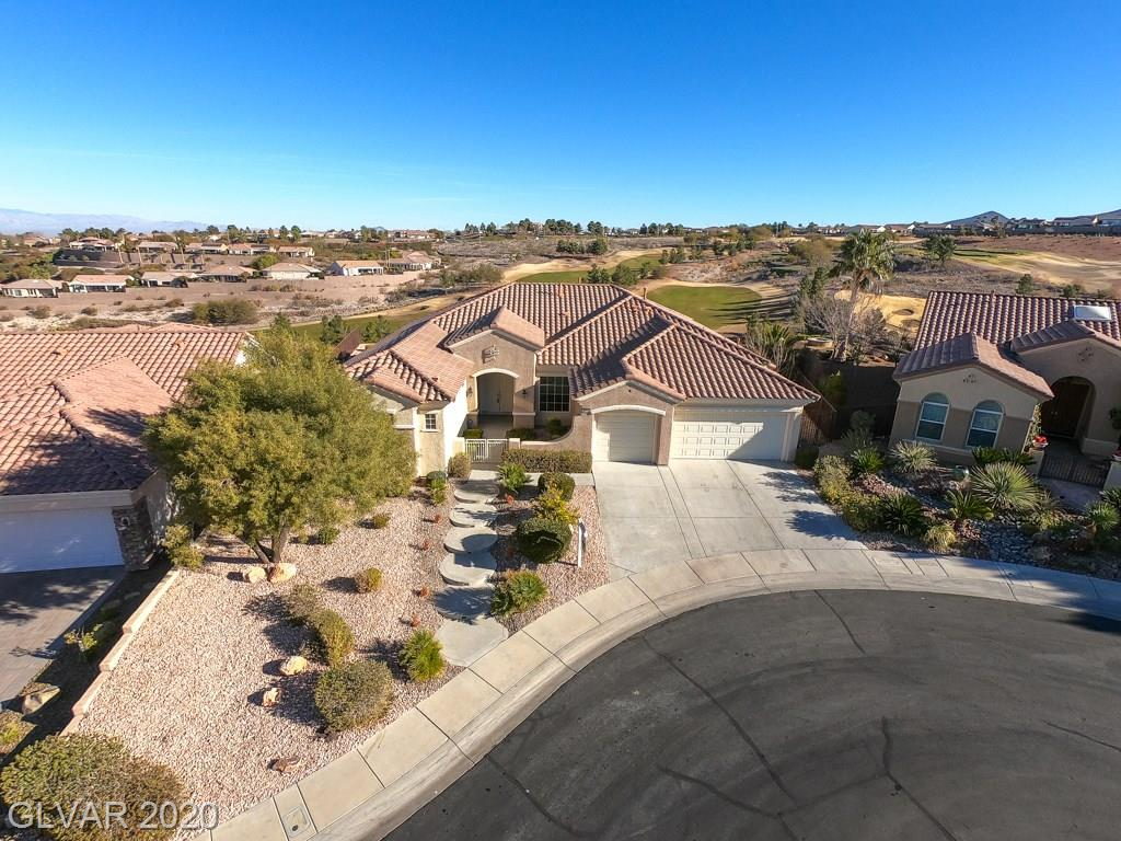 Highly upgraded Anthem floorplan w/SPECTACULAR Las Vegas Strip, City, Golf Course, and Mountain Views, on premium oversized Cul-De-Sac lot with Pool & Spa! Island kitchen w/Skylights, Granite Counters, Upgraded Cabinets. Huge MBR w/Sitting Area, 2 W/I Closets, Mirrored Closet Doors, Dual Sinks & Makeup Vanities, Shower & separate Garden Tub. Formal LR/DR w/Wet Bar. Family Room w/Gas Fireplace. Alarm system, 2-tone paint, upgraded flooring, more!