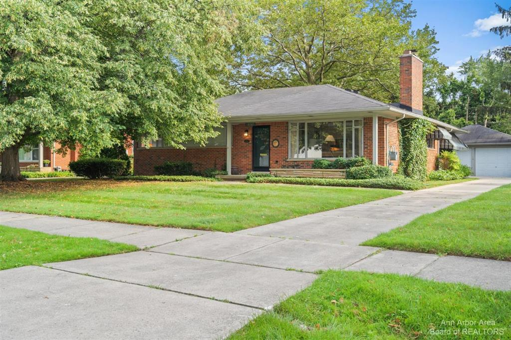 Sleek, brick, mid-century modern ranch in a lovely tree-lined neighborhood.  Many original features can be found throughout this terrific home.  A slate-tiled entry leads to the living room which features large windows, a masonry fireplace, and a built-in bookshelf.  The formal dining area has space for both formal and informal gatherings.  The efficient, eat-in kitchen has wood cabinets and a large window overlooking the delightful backyard.  Three bedrooms, each with ample closet storage, also have large windows.  The vintage, mud-set tiled full and half baths are conveniently located and in great condition.  Double French doors off the formal dining space lead to a three season sunroom.  The full basement has a generous 1960s family/game room, as well as a separate storage room, and large laundry room with large storage closet.  A private, partially fenced backyard provides plenty of space for relaxing, entertaining, or gardening.  Detached, two-car garage.  Minutes from Beverly Hil