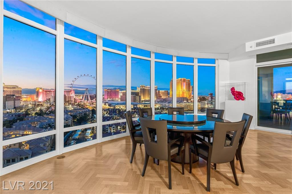 With over 3,500 square feet of impeccably-designed high-rise luxury as your urban pied-a-terre, you will be sure to enjoy the time you spend in your private domain in Las Vegas. This view-filled 17th-floor residence is a sensory experience beyond measure. The three-bedroom, four-bath corner unit boasts floor-to-ceiling glass walls in the major living spaces, a colorful ambiance both indoors and out, wraparound balconies, and all the building amenities you could wish for. Designed and built by the noted Irwin Molasky, there is no detail left unaddressed in this condo unit. Luxuriate in the privacy of your contemporary space, or entertain in style with a well-designed kitchen, stunning dining area, and expansive great room to accommodate both formal and casual gatherings. Two terraces invite outdoor lounging when the weather is great. Two assigned parking spaces suitable for electric vehicles are included as part of the amenity package.