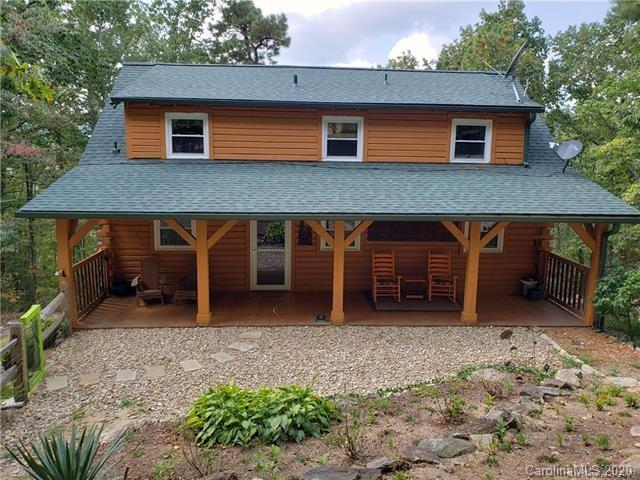Log Cabin home with Lake Summit Amenities for Boating Activities. This 3 bedroom 2 bath has been remodeled in the past 3 years. New Kitchen, HVAC, Windows, Ext doors, Roof, Woodstove, Ext paint, Log Cabin Chinking, and Fencing. This private location is ideal for Relaxing, Entertaining and Enjoying Nature, The basement finished space has been used as a office/gym area while still leaving plenty of space in an unfinished side for storage and projects with a workshop on that side. Easy commutes to Hendersonville, Greenville or Asheville. Don't miss seeing this Immaculately kept Log Cabin that is perfect for Vacation home, Air B&B, or your Forever Home! Seller is an NC Licensed Realtor