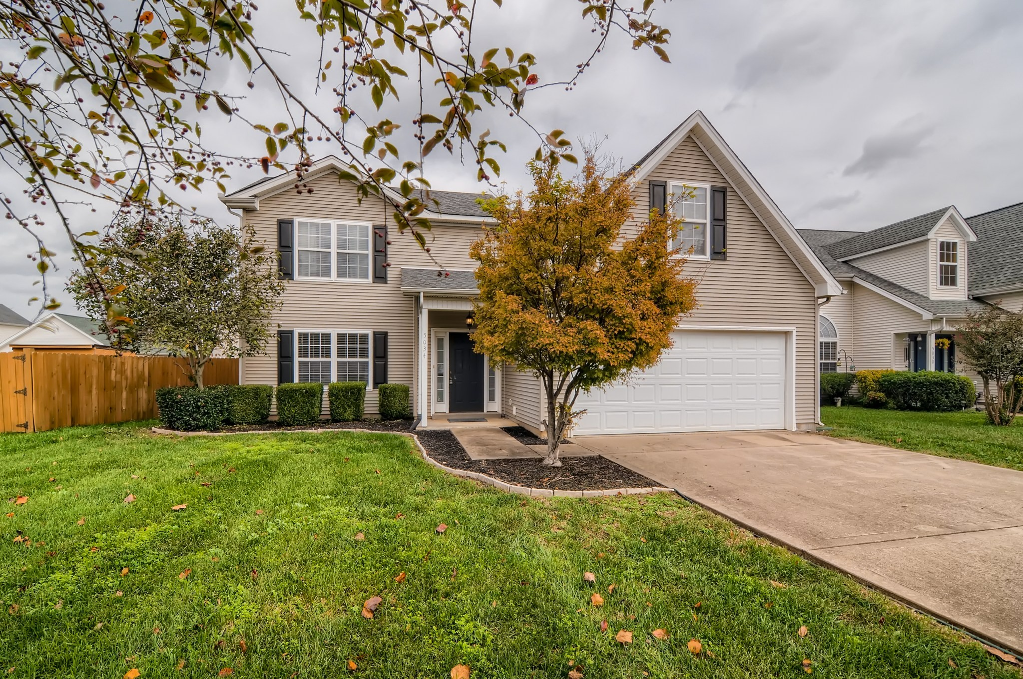 Minutes to Veterans Parkway, I-840, I-24, and The Avenue. The kitchen features stainless appliances & white cabinets. Newer tile & laminate floors. Masterbath garden tub. Approximately 400 ft unfinished bonus room. Professional landscaping & privacy fence. In a cul-de-sac!
