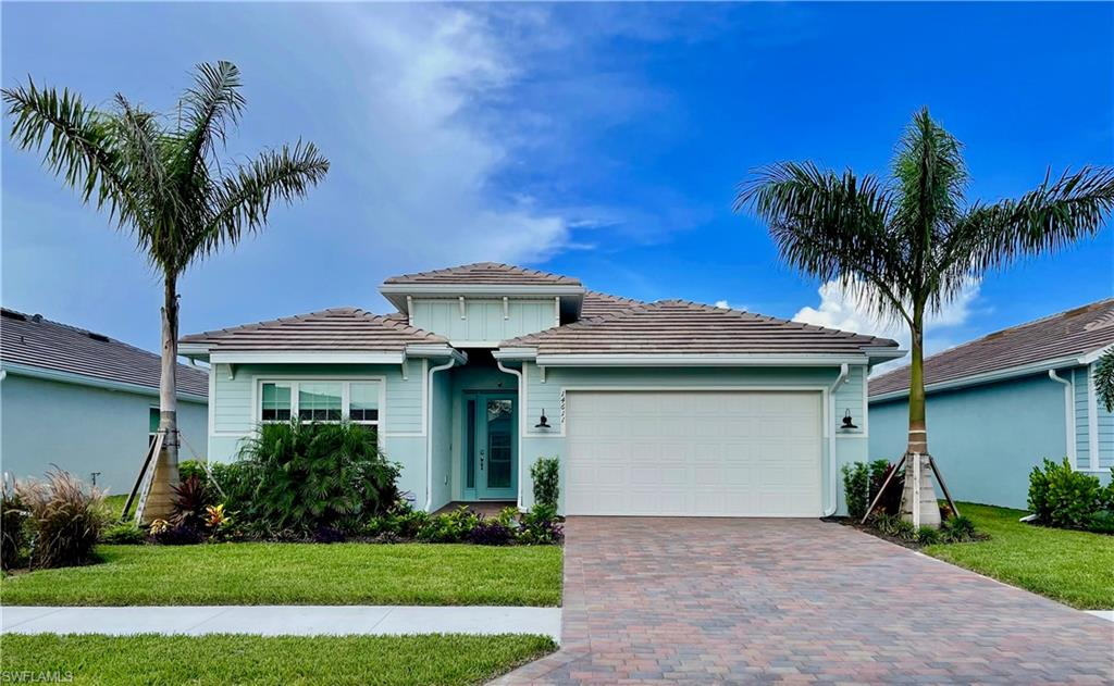 """Amazing Barrymore floor plan shows like a model & being sold turnkey! Pristine condition & only 5 months new! Features a HUGE 2 car Garage (the 2-Car side is extra deep/tandem). Impact windows & slider throughout! Custom Pool/Spa with pool bath, w/picture frame cage & sun deck. Kitchen features linen cabinets, upgraded Quartz counters & upgraded stainless steel appliances. 18"""" tile on diagonal throughout entire home. Private & professionally landscaped lot w/tropical view. Community amenities include: Guarded gate, 22 lakes, 1-mile-long Boating/Rowing lane, Boat ramp, Island Club, Fitness center,2 Bocce ball courts, Outdoor fitness stations, Beach volleyball, Tiki bar & café with food & Beverage service (no minimum spend), Resort style pool with lap lanes, Fire pit, Private Kontiki Island, use of Electric boats Stand-up paddle boards, Kayaks, Canoes & Bicycles, Tennis & Pickle ball courts, Pickle ball and Tennis & 2 Dog parks, Community Gardens, Miles of walking/biking paths, Fishing and Gardening clubs, Basketball court, a Children's play area! Onsite property management/Lifestyle director. Golf carts allowed!  Low HOA fees. THIS HOME IS AN ABSOLUTE MUST SEE.  WHY WAIT TO BUILD."""
