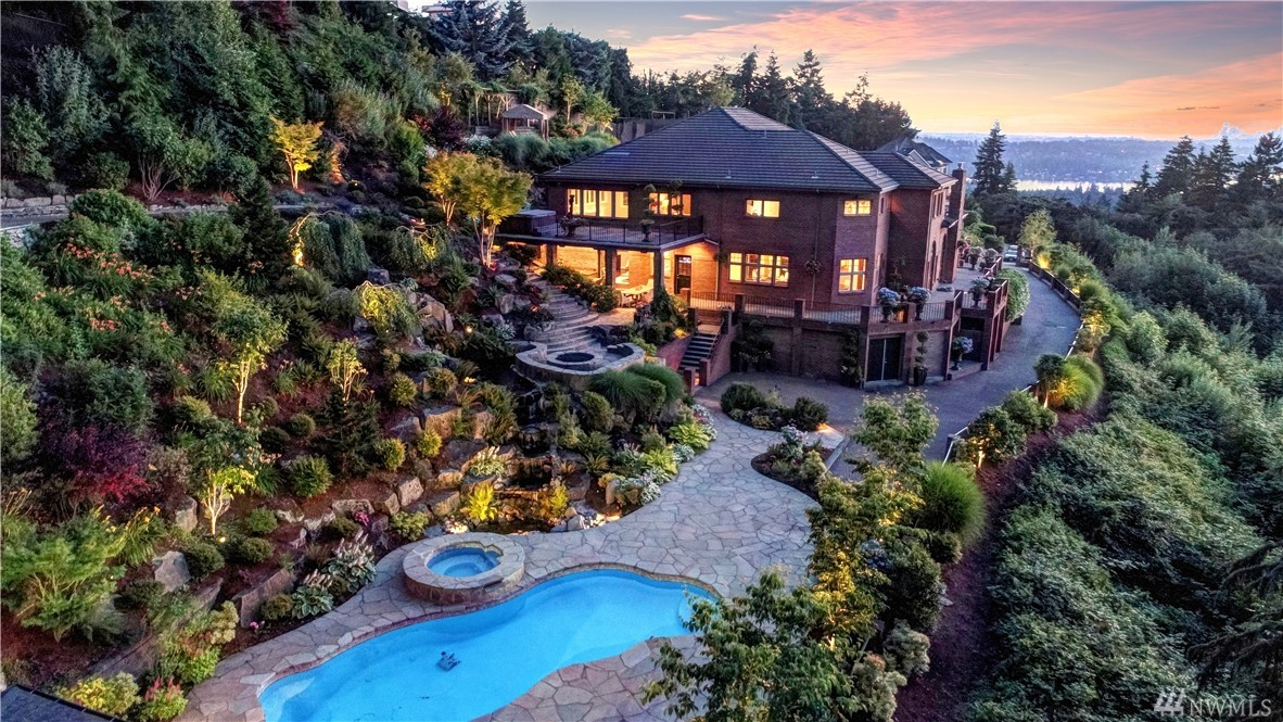 Privacy abounds in this Somerset estate on an immaculately landscaped 3+ acre lot. Unparalleled & unobstructed 180 degree view of Lake WA, Seattle & Bellevue Skylines, Olympic & Cascade Mtns. Western exposure provides breathtaking sunsets! Inviting interior spaces & spa-like amenities throughout. Backyard oasis w/stunning pool, hot tub, sports court, putting green, & cascading waterfall. Easy access to Factoria Mall, DT Bellevue, I-90, I-405. Located within best school district in Washington!
