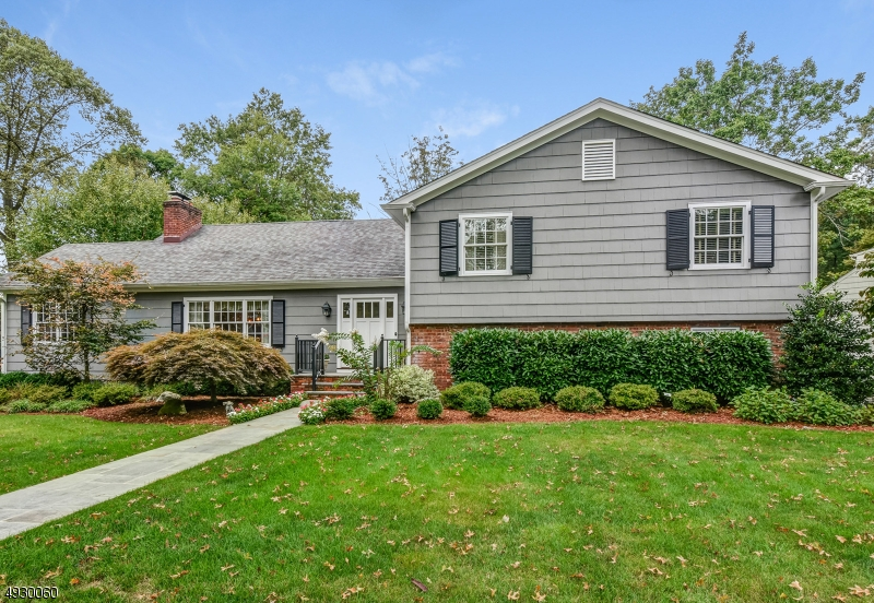 Absolute turn-key 4 Bed / 3 Bath split renovated in 2012 is tucked quietly away near the Watchung Reservation. 1st level foyer greets you as you turn into L/R w/gas fireplace, elegant formal DR & den w/2nd fireplace. The gourmet kitchen features high-end Sub-Zero & Miele S/S appliances, cherry cabinets & granite counters w/slider leading onto the new Trex deck overlooking the tranquil, park-like yard. The 2nd level houses the master suite w/double closets & private bath, plus 2 more B/R's & main bath & large 4th B/R on 3rd level. F/R & newer full bath on ground level. Updates include newer Pella windows, gorgeous moldings throughout, refinished HWD floors, new garage door & fresh ext. paint, blue stone walkway & much more! Plus 2-zone heat & CAC, whole house generator, reverse osmosis system & shed.