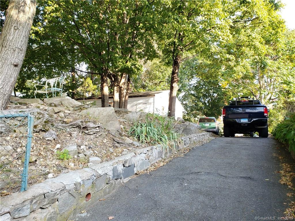 This lot has a nice size garage in the back. Buyer is responsible for due diligence.