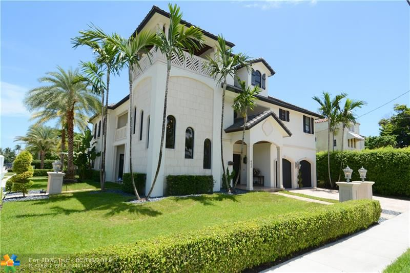 Located in the picturesque Idlewyld community, this lavish custom estate is the epitome of refined luxury. Amazing chef's kitchen w/top of the line appliances. Spacious master suite w/sitting area, his/her bathrooms & walk in closets. Tranquil backyard w/salt water pool, lush landscaping & covered verandas. Full house generator & rooftop terrace. Audio technology & media room. Furniture negotiable. One year membership free for either Harbor Beach Marriott or Lago Mar. Walking distance to beach & more!