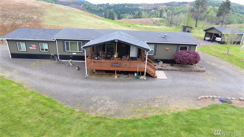 Location! Location! Location! - How about life on the lake? This very well kept home sits right near the entrance to Riffe Lake with stunning lake views.  Imagine sitting on the covered deck taking in the vast views. This 3 bed, 2 bath has many perks including an attached 2 stall garage, barn/shop, front & rear decks, pasture land, mature landscaping, firepit area & raised garden bed. There is plenty of space for parking RV's, boats, etc. or maybe use the pasture for a critter or 2.