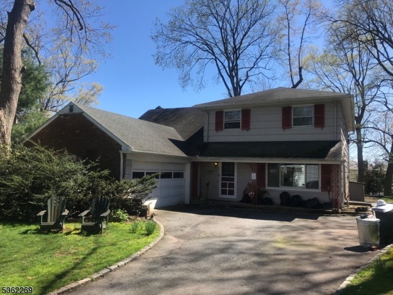 """Five bedroom home on desirable cul-de-sac. Needs complete renovation. Being Sold """"AS-IS"""" First floor bedroom and bath are handicap accessible. Dining room with French doors opening to large deck overlooking nearly a half acre wooded property. Large master bedroom with jetted tub."""