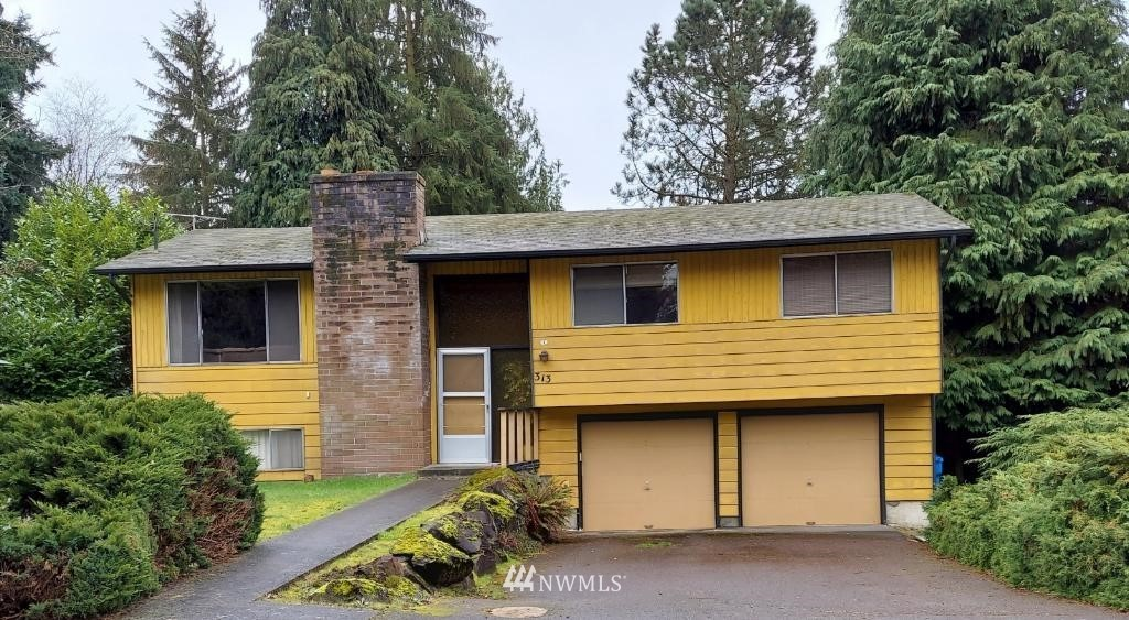 MUR-70 zoning. Value in the land. Walk to future Shoreline light rail station near 145th. Large flat level lot. Potential short term rental as interim use.