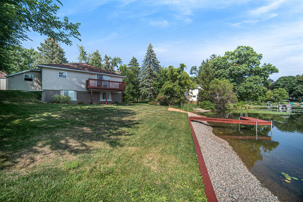 You have to see this lakeside dream! This cozy waterfront property sits on the quiet, peaceful Perch lake making it a perfect resort you can call home. Inside features four bedrooms, two full baths, and a walkout basement. You can enjoy the breeze with plenty of ceiling fans while admiring the insert corn burning fireplace and knotted pine ceiling lined with updated cove. Outside features a dock, large deck, and plenty of parking with a carport and 2 garage. The home is move in ready for a buyer looking for paradise!