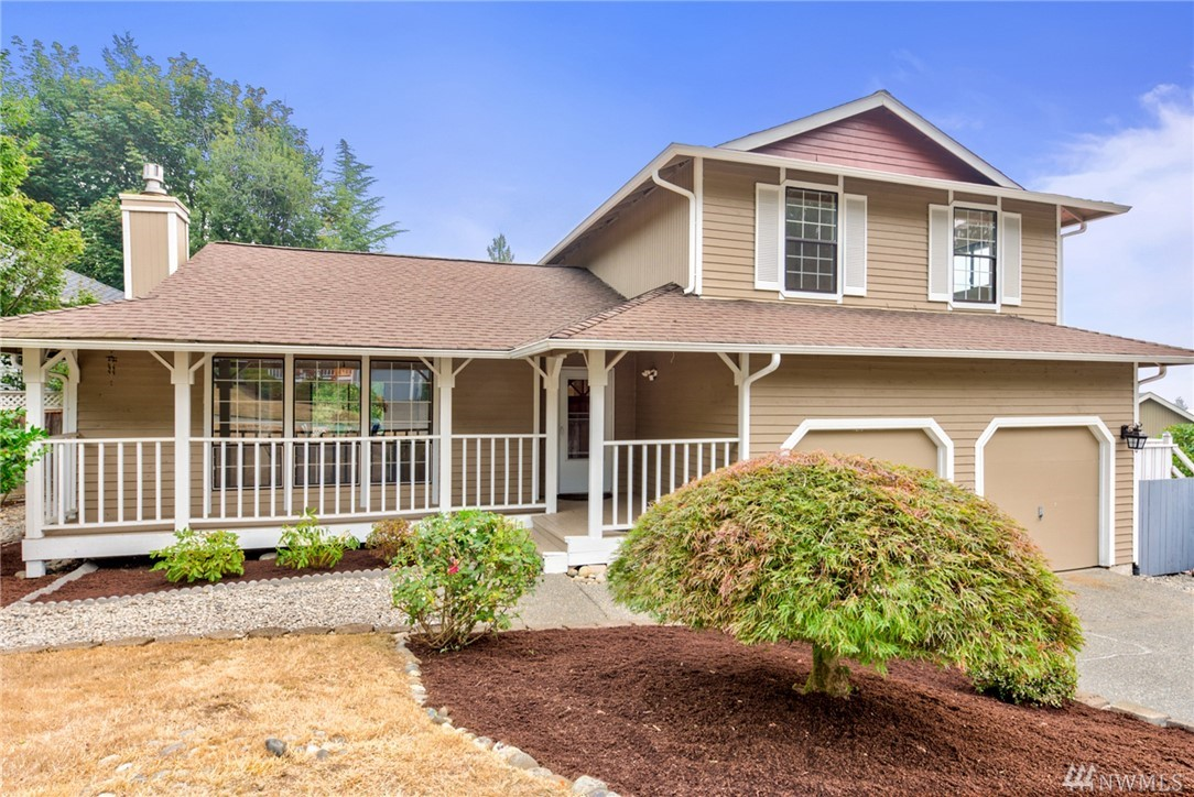 Great location! Convenient access to I-90, I-405 & walking distance to Issaquah Transit Center. Inviting Entry features hardwood floors all main level & vaulted ceilings. Spacious Living /Dining  feature a granite faced gas fireplace. Bright Kitchen boasts plenty of work space & opens to a Family Room w/ wood floors & French Doors to a balcony w/ City and Mt Views. Master Suite includes double vanity, walk-in closet. An entertainment sized deck & spacious side yard fully fenced for activities.