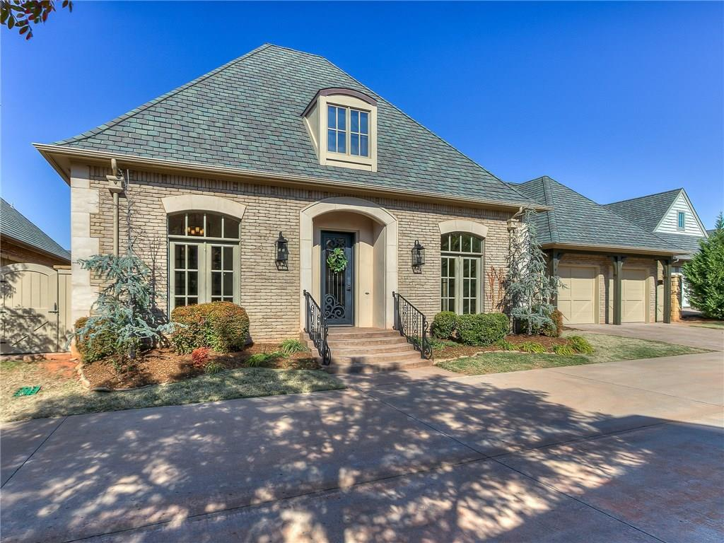Former Parade Home with all the extras! Timeless classic design with stunning gourmet kitchen with Viking appliances & great storage. Enjoy the lovely side terrace while sipping your morning coffee or afternoon beverage. Beautiful Wood floors throughout the downstairs. 2 living areas versatile for your personal preferences both with fireplaces plus an impressive study with built-ins. Spacious family room opens to kitchen with surround sound & a view of the covered patio featuring brick arches, an outdoor fireplace + built in grill. Spacious  master closet connects to laundry room for extra convenience. Oversized Upstairs theater room, bar & bath with plenty of walk-out storage! $50,000+ in recent updates! Painted kitchen cabinets, quartz countertops, under-counter lighting, paint throughout, light fixtures & hardware! Muirfield Village is ideally located for living convenience near restaurants, shopping, turnpike, & medical facilities. Enjoy maintenance free living at its finest.