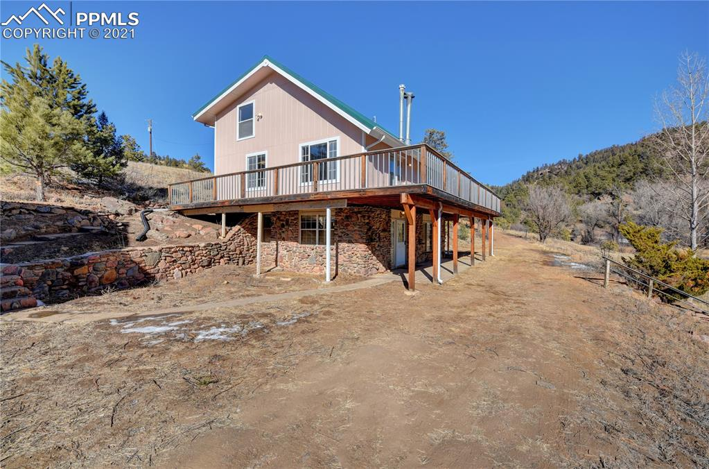 When you picture your dream home in the mountains, this is it! Sitting on 5 acres with a creek and bordering BLM, this property is ideal! This 3 bed, 3 bath, oversized 2 car garage would be perfect for a full time residence or second home. Features include a wet bar, vaulted ceilings and beautiful rock wall behind the wood burning pellet stove to cozy up on those picturesque, rocky mountain snowy days. All 3 bedrooms are large in size and having a living room and family room give plenty of space to spread out. New metal roof within the last 6 months, fresh exterior paint within the last 2 months and composite patio make for little to no maintenance. The 24'×30' oversized garage has excellent workshop space and upstairs could be finished as a studio, in law suite or awesome gameroom! From the southwest corner of the property, you have access to over 10,000 acres of BLM. This property has it all!