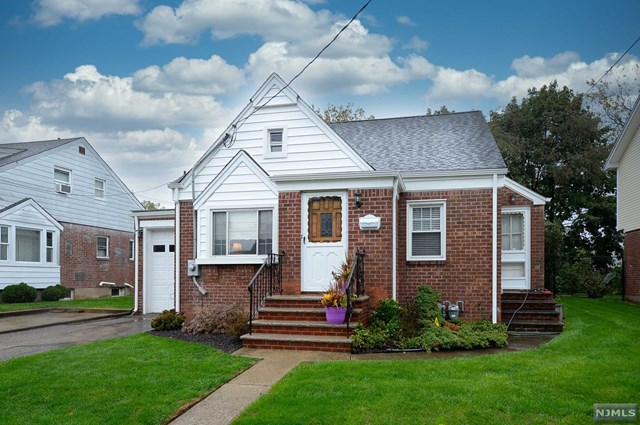 THIS 3 BEDROOM TWO BATH CAPE HAS GREAT SPACE AND A FLOW FOR ENTERTAINING. THE DINING ROOM OPENS TO THE VERY FUNCTIONAL KITCHEN WITH GLEAMING STAINLESS STEEL APPLIANCES, BUILT IN CABINETS AND CUSTOM PANTRY.  THE FIRST BEDROOM ON THIS FLOOR HAS ACCESS TO THE SUNROOM AND YARD. A LARGE BRIGHT LIVING ROOM, ANOTHER BEDROOM AND A FULL BATH COMPLETE THIS LEVEL. THE SECOND FLOOR HOSTS ANOTHER FULL BATH, A BEDROOM WITH A COZY ALCOVE AND AN OFFICE/DEN WITH BUILT IN SHELVES FOR EXTRA STORAGE. PARTIALLY FINISHED BASEMENT HAS REC ROOM  AND LAUNDRY/UTILITIES. HARDWOOD UNDER CARPETING ON FIRST FLOOR, GAS HEAT/AC READY, DOUBLE WIDE DRIVEWAY, NEWER ROOF/SIDING, ATTACHED ONE CAR GARAGE. PATIO/BBQ AREA OFF THE SCREENED IN PORCH FOR SUMMER GATHERINGS.  HERE IS YOUR OPPORTUNITY TO LIVE IN ONE OF THE TOP 25 SMALL TOWNS TO LIVE IN NJ! THIS HOME HAS BEEN LOVINGLY MAINTAINED AND IS READY FOR YOU TO CREATE YOUR OWN MEMORIES! CLOSE TO SHOPPING, LIBRARY, TRANSPORTATION, AND GREAT SCHOOLS.