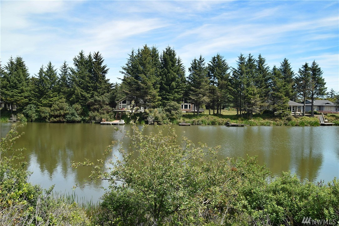 Beautiful lakefront lot in the best location you will find in Ocean Shores. Set on a quiet street with 60 feet of lake frontage. This awesome lot has water already installed on the property as well as sewer and power ready for hook up. Build a dock out on the water and you are also allowed to camp up to 90 days a year. This lot is buildable and is set in a very nice neighborhood of waterfront properties. LID paid in full.