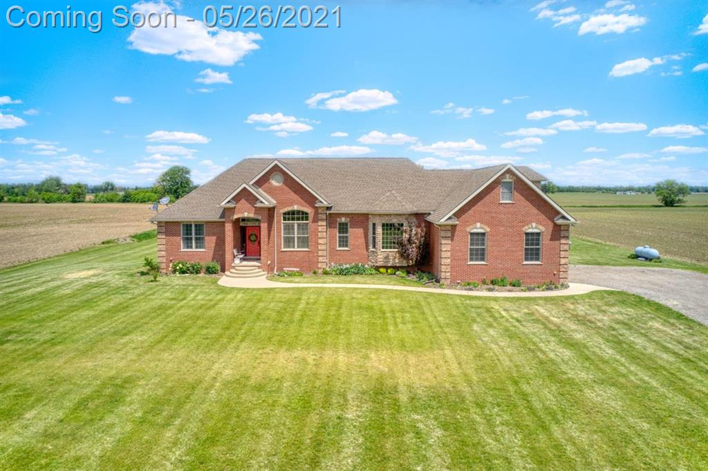 Wow, what a beautiful brick home on a five acre country setting.  Great property for the large family, with easy access to US 23, located between Ann Arbor and Toledo.  4 bedrooms, 3 full baths and 1 half bath with over 3000 sq ft of custom living space.  The home's layout is fantastic.  Large custom chef's kitchen with granite, stainless appliances, double ovens, cooktop, and beautiful tile flooring.  Huge master suite with incredible master bath.  Large 2nd and 3rd bedrooms share a Jack & Jill bath.  4th bedroom (au pair suite, in-law suite, whatever you want to call it) with full bath located away from others for extra privacy.  Home office and the nicest mud room ever are huge bonuses.  Main floor laundry room.  Vaulted ceilings and a gas fireplace make the living room the place to hang out.  Basement is approximately 2900 sq ft of high ceilings, plumbed for 4th full bath, wired, and 4 egress windows allow for possible 5th and 6th bedrooms.  Great water, high speed internet availab