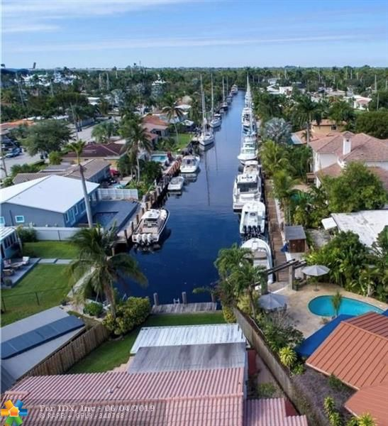 Awesome deep water location with direct view down the canal to the New River. This home has 2 bedrooms and 2 full baths, all redone. Granite and stainless in the kitchen. This home is less than 10 minutes to Las Olas, the beach and Ft. Lauderdale airport. Very easy access to I-95, 595 and Florida's turnpike. Full hurricane protection utilizing both accordions and panels. Neighborhood park 5 minutes away with workout station and kid's playground. The dock is 20 feet long and will accommodate a 20 foot boat.