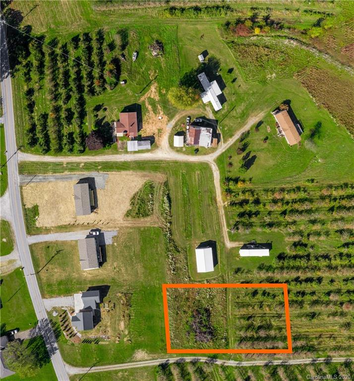 Long-range views of Bald Rock with producing apple trees on the property! This parcel is a portion of a larger tract offering a subdivision named Pilot View. The only restrictions are must have underground utilities, off-frame modular or stick built, and cannot be subdivided. So bring your boat, chickens, goats, or recreational vehicles. You'll love the proximity to local vineyards, apple orchards, and pear farm. Lot5 contains 0.66 acres, more or less. Buy the lot now, and build your dream home on your timeframe.   The orange lines on the picture are not exact. Just for general reference.
