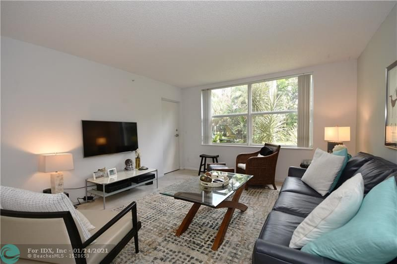 Beautiful and quiet, ideally located condo minutes from the beach in the heart of Fort Lauderdale! Updated 1/1.5 unit with screened balcony, serene views overlooking garden area, and bridge with updated kitchen, floors and impact windows. Clean and ready for move-in! This community is walking distance of various shops, banks, restaurants, fitness centers, and 10 minutes to the beach! Fresh Market and Coral Ridge Mall just minutes away! Community features lovely pool area and sauna.