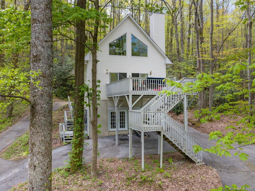 Delight in a gorgeously renovated mountain lake cottage. All new kitchen & baths, roof, HVAC, septic, fixtures, flooring & paint create a fresh feel throughout. Located atop a hill overlooking the pristine, 28-acre Lake Sheila, this property allows for privacy & ever changing views. Stone fireplace & cathedral ceilings frame a great room that opens to the treetops through large windows & doorway to spacious deck perfect for entertaining. Walkout daylight basement with 10 foot tall ceilings can be easily finished as an income-producing apartment, workshop, studio, or additional living space. This home is for those seeking everyday access to swimming, fishing, boating, & having fun at the lake &, of course, just relaxing in the beauty of nature. Only 4.3 miles to downtown Saluda, NC for dining, shopping, & more. Buyer can negotiate purchasing the home fully furnished for a turnkey transaction!  Easy to show because not occupied full time. Come see what your lake life can look like.