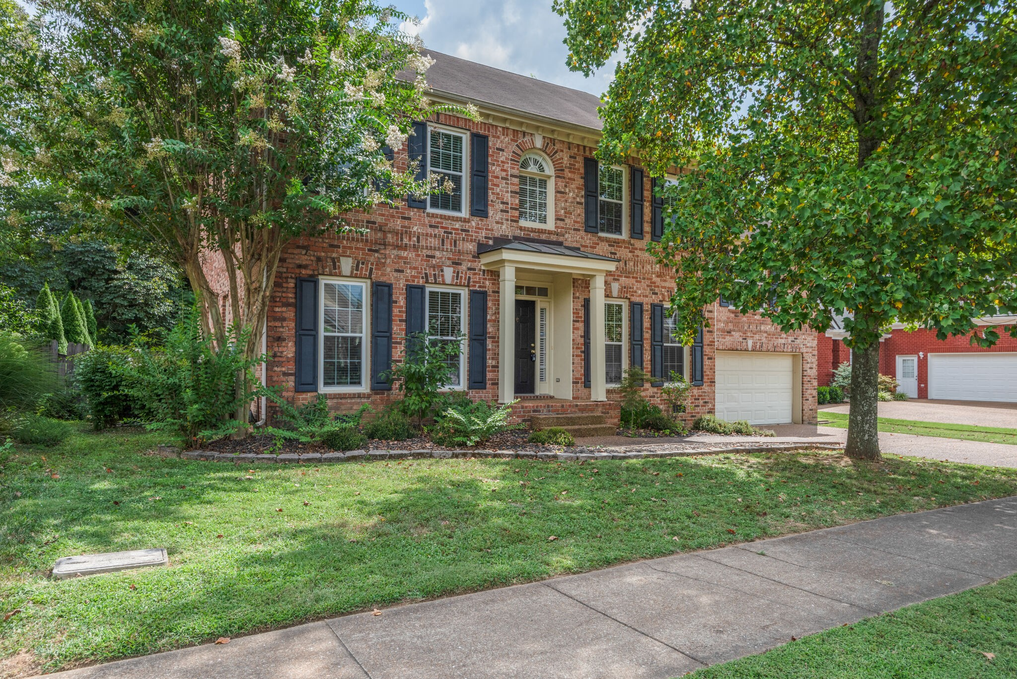 Open Sunday 8-16 2:00 - 4:00 All Brick Polk Place home. New Updates as of this week!! Impressive kitchen! Gorgeous granite and backsplash.! Brand new stainless Fridge! Tankless hot water heater - water is always hot!!  Awesome huge mid-level bonus room. Large back deck overlooking very private fenced back yard. Convenient, quiet, sought after neighborhood w/sidewalks, community pool and pond stocked w/fish for residents. Only 2 miles to downtown historic Franklin.