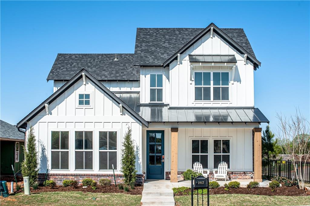 This Modern Farmhouse home is our Orwell plan which is the ideal family floor plan! This timeless open floor plan with lots of natural lighting will be great for entertaining your family and friends. This home allows you to combine your indoor and outdoor entertaining spaces with the window wall Western door system to the screened in porch. You will love the large master retreat downstairs with spacious closet that connects to the utility room. Downstairs is an additional bedroom with a full bath. Upstairs offers an additional bedroom and full bath with great media/game room for lots of family time. Town Square is Edmond's historically inspired community. Community featured with greenbelt, fishing pond, and a floating deck. Town Square Residents Club with a clubhouse, resort-styled pool, state-of-the-art fitness center, and much more is now open! Model home at 1616 Boathouse Road, open 7 days a week.