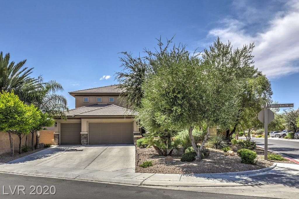 Amazing Home in Premier Guard Gated Club Aliante.  SID IS PAID OFF!!  11,326 Sq. Ft. Corner Lot, 2 New AC Units -One 5 Ton & One 3.5 Ton -Both High End Efficiency, New Hot Water Heater, New Garage Door Opener, New Variable Speed High Efficiency Pool Pump, New Pool Heater - 1 yr.  This Beautiful 2 Story Home Has a 54'x16' Heated Pool with Waterfall & Spillover Bowls.  Interior of Home has Vaulted Ceilings, Gorgeous Wood Floors & Wood Shutters Throughout, Ceiling Fans w/Lights, Beautiful Open Railing on Stairs & From Loft Overlooking the Family Room. Gas Fireplace, Kitchen w/Breakfast Bar, Stainless Steel Appliances Including Double Ovens.  Master Bath has Dual Counters, Make Up Table, Modern Walk-in Shower w/o Door, Large Tub, Huge Walk-in Closet, Modern Neutral Tile with Appearance of Stone, 4 Full Baths w/Modern Finishes, 3 Car Garage, Courtyard at Front of House, Security Door too!