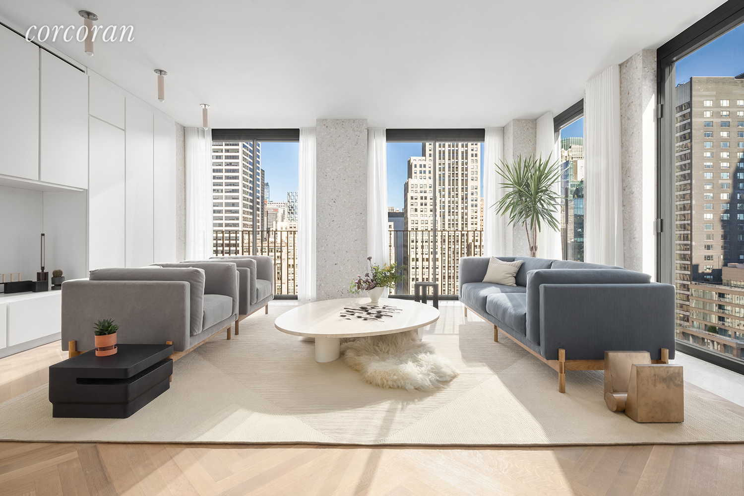 The Bryant is pleased to welcome you back and is now available for private in-person appointments with new health and safety standards.  Please contact the sales team for a virtual first appointment and in-person follow up appointments.  Located high above vibrant Bryant Park in the heart of New York City, this David Chipperfield-designed floor-through two bedroom (possible 3 bed) residence with a windowed study boasts twenty two floor-to-ceiling windows wrapping three exposures. At 1,882 square feet (174.8 sq. m.), this home offers an expansive floorplan with an abundance of natural light and incomparable views of Bryant Park and the Empire State Building through Vitrocsa sliding glass doors with Juliet balconies. The custom terrazzo facade transitions seamlessly to the interiors, creating crisp architectural frames to the windows and a border for the heated oak herringbone floors. The residence's bespoke millwork cleverly conceals storage, appliances and mechanical systems, allowing continuous, full 9' 6' inch ceiling heights to carry throughout the residence. The open kitchen includes a Gaggenau cooktop with fully-vented hood, oven, speed oven, dishwasher, and refrigerator/freezer. The master bedroom with direct Empire State Building and city views includes a windowed en-suite bath featuring full-height Statuarietto marble walls, double vanity with marble top, and separate water closet and wet room with rain shower, both enclosed behind custom Bendheim glass doors. The secondary bath and powder room are also appointed with Statuarietto slab marble walls and vanity. Residences at The Bryant, located at 16 West 40th Street, sit atop a luxury boutique hotel. Amenities include 24-hour attended private residential lobby, lobby lounge, fitness center with sauna, Terrace Club with fireplace and full bar overlooking Bryant Park, and a full suite of a la carte hotel services including housekeeping and room service. Immediate Occupancy.