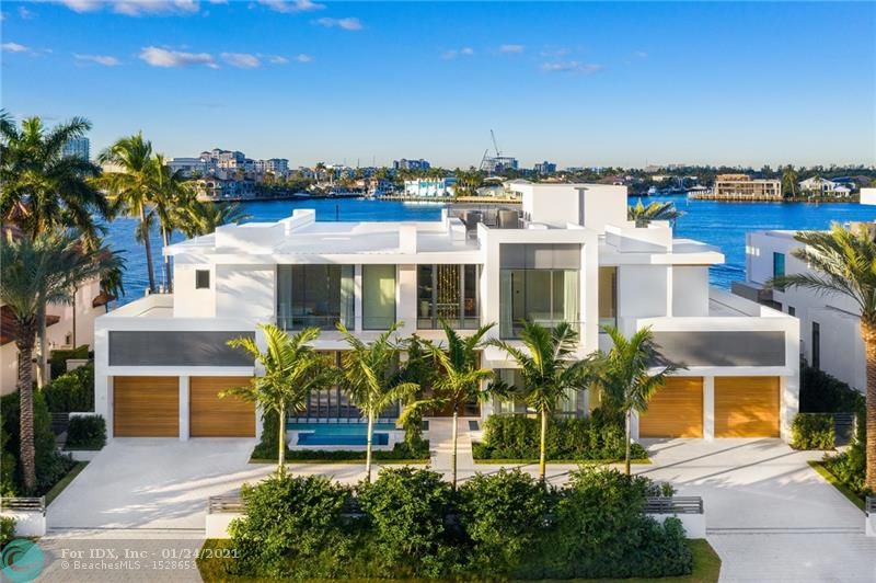 ONE OF A KIND custom home in prestigious Harbor Beach! This modern masterpiece was designed by Randall Stofft Architects & built by prestigious Sarkela Corp. No expense was spared, features include DuChateau oak floors, Italian cabinetry, 2-story marble fireplace, Dornbracht bath fixtures, 200 bottle wine cellar & Crestron smart home system. Being offered turnkey w/signature Terzani chandeliers, imported custom furniture & artwork, + generator. Open floor plan w/impressive great room, club room, eat-in kitchen w/high end appliances & separate prep kitchen. Oversized master suite w/his & hers bathrooms. Awe-inspiring Intracoastal views draw you outside to the generous outdoor entertaining space w/outdoor kitchen, lap pool & vast covered areas. Minutes to the ocean, dock your mega yacht here