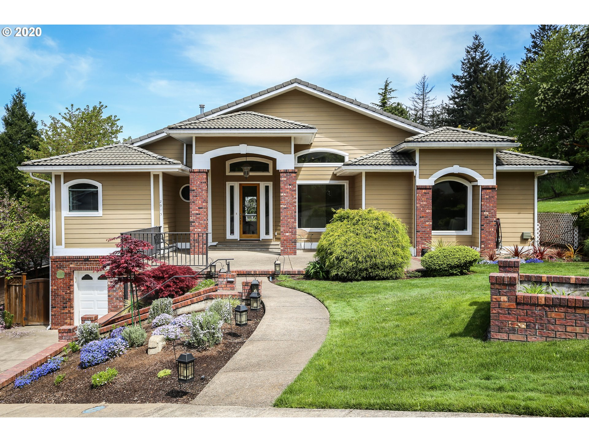 Stunning E Eugene Home. 5bed, 5bath, 5492 Sq ft, 2 level. Main level hosts maple wood floors & high ceilings, master suite with balcony access, fireplace, window seat, walk-in his & her closets, walk-in shower, jetted tub, gourmet kitchen w/ granite, double oven, gas cooktop, pantry & buttlers pantry. Eating area + formal dining room. Finished basement comes with another kitchen, living & dining room, bedrooms, baths, storage & garages. Beautiful back yard, Lrge covered patio/entertaining space