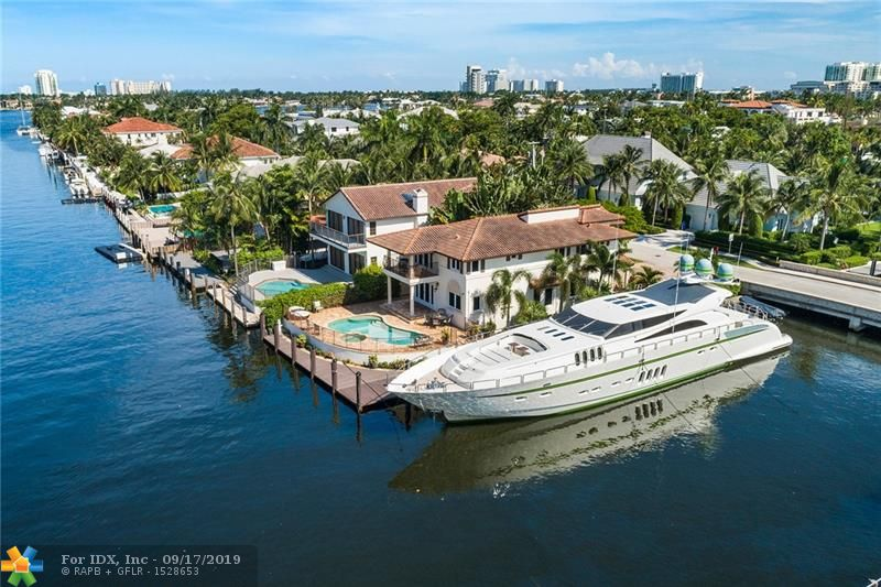 """This stunning Mediterranean Villa sits on an interior point lot in Rio Vista Isles and boasts a 125' dock AND a 50' dock for the Mega Yachtsman!  3 power pedestals with metered electricity. Recent interior and exterior paint and renovations along with decorator furnishings make this a turnkey """"lock and leave"""" vacation home! Gleaming wood floors, an open concept chef's kitchen & large comfortable living space along with a full bath occupy the 1st floor. The 2nd floor offers 4 bedrooms & 3 additional baths. """"Water Water Everywhere"""" views and a large sunny pool with spa complete this picture perfect offering."""