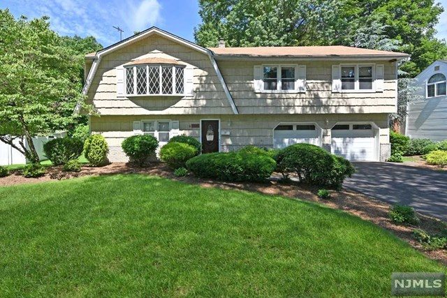 Recently painted! Great opportunity to get into prestigious River Edge on a prime street at a great price! 4 BRs, 2.5 baths, including master BR w/master bthrm! Over 2,000 sq ft of living space w/ground flr family rm w/fireplace (never used so AS-IS) & 4th BR (currently used as studio) but w/half bath as well so great for extended family too! Open Layout on 2nd Flr w/LG living Rm into Dining Rm into Eat-In Kitchen, plus 3 good size BRs & 2nd Full bthrm. Sliding drs from ground level lead to a nice backyard w/patio - ready for your outdoor Summer fun! Backyard faces Bergen's famous Van Saun Park! Enjoy all that Van Saun has to offer just a few steps away! 2 car garage, central AC, attractive bay windows, newer hot water heater, new driveway, & all on one of River Edge's most desirable cul-de-sacs! Some updates needed, but priced w/this in mind, so bring your design ideas & make this your new home on a great street! Sellers Motivated! Sellers dont need to pay flood insurance!
