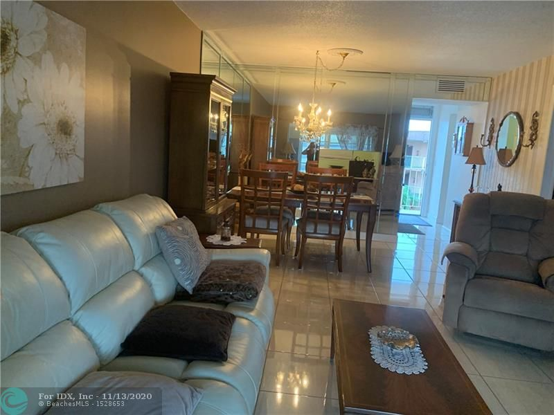 Spacious condo totally furnish, turn key. Remodel kitchen and bathroom, tiles through out, nice furnitures. Hurricane shutter in the patio door. beautiful view of the pool. Low HOA fee, Internet included in an addition of $100. per year. Roof redone, building in very good condition. Good location access to main road, close to shops, airport and beach. Community offering: Heated pool, BBQ area, billiard and exercise room, shuffleboard, pétanque, shows and much more.