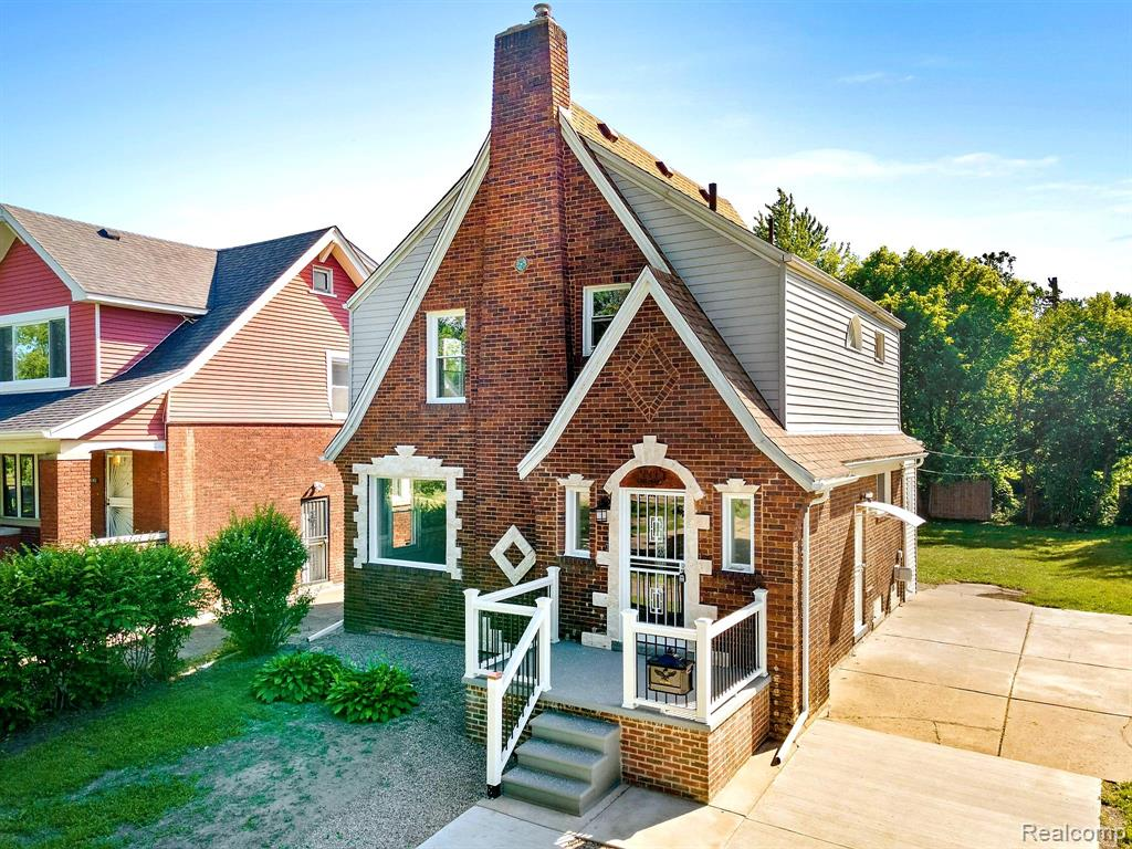The pride of the Jefferson Chalmers neighborhood is showcased here with this 1920's era colonial that has been tastefully reinvigorated TO THE 9's! This gem has formal living and dining rooms, breakfast nook with heaps of natural sunlight, a 2nd floor balcony that's great for sunbathing and a contemporary kitchen that's situated for entertainment. The kitchen opens up to the dining area (w/ bar style seating) through the breakfast nook and out to the deck where many of cocktails may be had.  Feel comfortable that the following are new or newer: vinyl windows, concrete driveway, 3D roof, electric FP, all 3 porches/balcony, furnace, elect panel, hot water heater, bathroom & lav, kitchen, carpeting (LR and BR's), engineered flooring (kitchen, DR & breakfast nook), interior doors, entry & security doors (front, bk & side). The kitchen flaunts its granite counters, brown-veined ivory backsplash, SS-aproned undermount sink, and SS appliances. Home warranty included for the fussy ones!