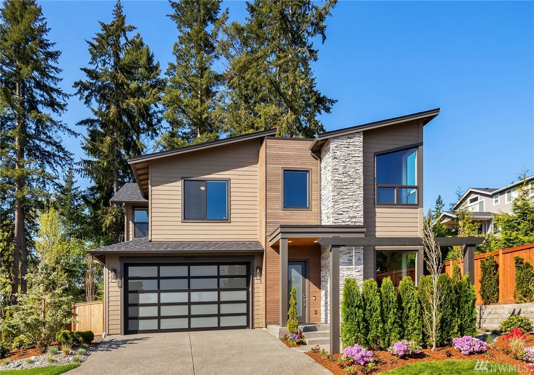 Contemporary new construction by Terrene Homes in popular English Hill! Incredible great room features a chef's kitchen & inviting family room. The breakfast nook opens to a private patio & fully fenced yard overlooking a beautiful, lush setting. Pass through butler's pantry to the formal dining room. Main floor office, flex room & 3/4 bath. Luxurious master, spa-inspired bath + 3 bedrooms & bonus up. Move-in ready with central A/C & all appliances. 3 car garage & top Lk WA schools. Welcome home