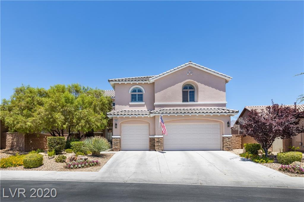 **Beautiful, spacious home in the guard-gated Club Aliante community! **Home boasts an open floor plan. **Vaulted ceilings. **Living, family, and dining rooms downstairs as well as a bedroom and full bathroom. **Huge master suite upstairs! **Custom walk-in closet with built-ins as well as a second walk-in closet. **Separate tub and shower in master bath. **Crown molding. **Granite counters. **Custom kitchen cabinets with pull-out drawers. **Custom backsplash **5 Large bedrooms. **8-foot doors. **Ceiling fans in all bedrooms. **Cozy fireplace. **Custom lighting fixtures throughout. **Beautiful large tile. **Custom Shutters. **4 bathrooms. **Spacious 3 car garage! **This residence has been maintained at the highest level. **New water-heater. **New AC-System. **Smart Home features exterior Smart-light switches, *door-sensors, *glass-break sensors, and *cameras. **Come in, take a look, and fall in love with it!