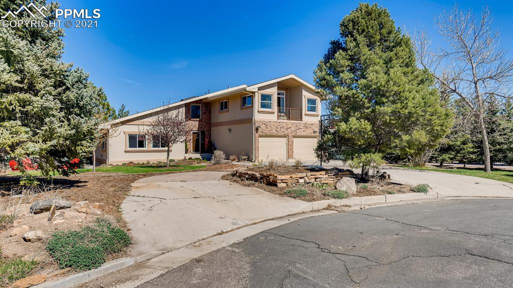 """It's all about LOCATION! LOCATION! LOCATION! Spectacular views of Pikes Peak and the city!  Situated on 2.3 acres at the end of a cul-de-sac on top of the Mesa. Backs to Mesa Valley trail, minutes to downtown. Upon entering the home, you will be impressed with the vaulted beamed ceilings, hardwood floors and large windows leading into the living room, dining room and kitchen. The updated kitchen includes custom cabinets, granite and wood countertops, large pantry and stainless-steel appliances. Also on the main level you will find a cozy family room with a wood burning fireplace and a walkout to the large Trex deck, a bedroom and a 3/4-sized bathroom. The upper level has an expansive master suite and attached 5-piece bathroom and an incredible view of Pikes Peak from the private balcony. The master also has a sitting room. The upper level has 2 additional bedrooms and a full-sized bathroom. The basement has a """"mother-in-law suite"""" with a kitchen with a full second set of appliances, 2 living areas including a wood burning stove, a bedroom, full-sized bathroom and walkout to the patio and backyard. The 2.3 acre lot extends to the trail below with the upper portion of the yard being fenced along with a shed and hot tub. On the side of the house, there is large gardening area along with a chicken coup. The front yard has a firepit to sit around on those perfect Colorado fall evenings. The home received stucco, new windows, a new boiler and central air two years ago. This home with it's location and views is as absolute must see and will sell quickly!"""