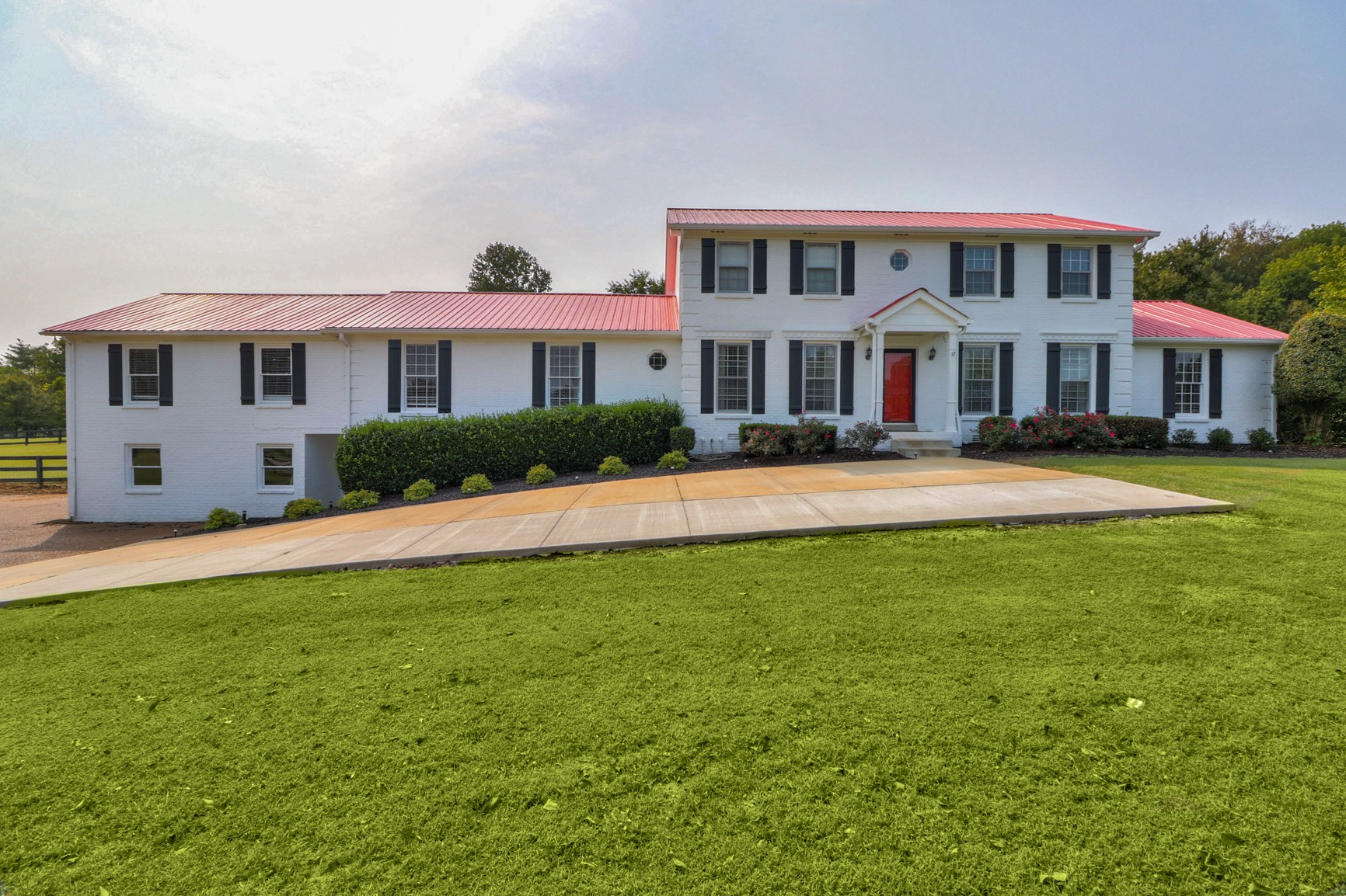 Amazing 3+ Acre Farmhouse  Estate ~ In-ground Pool with slide ~ Level Fenced Land ~ Separate Basement Apartment with its own entrance ~ Horses allowed ~ Master Bedroom on the Main ~ 2 Large Bonus Rooms ~ Very Flexible floorplan ~ 2 Covered Porches ~ Fantastic Location ~~ Fantastic Property !!!