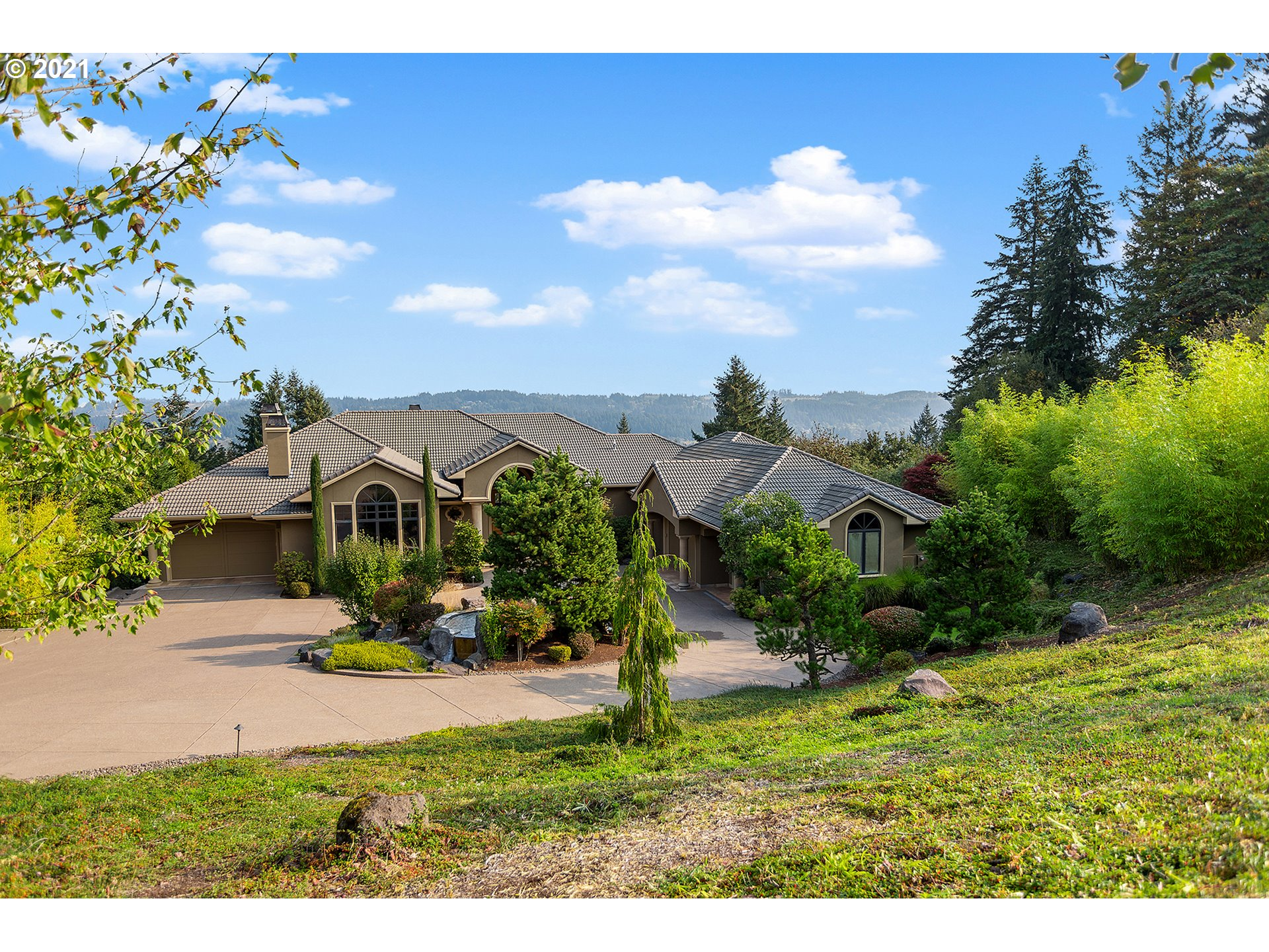 Wake to showstopping Mt. Hood views from 2 large & luxurious master suites on the main floor of this gated estate within the gated Stafford Hills Ranch. Modern, open floorplan great for living & entertaining in & out year-round on 2 levels of decks & 5 acres. Run your empire from the impressive 560 sq.ft. executive's office. Custom designed for an intl. fashion accessory designer & once home to former Trailblazer. Make this your escape.