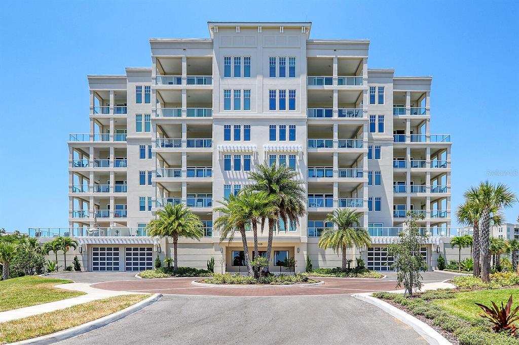 """This is a unique opportunity to purchase a 2079 sq ft luxury condominium in the Brightwater building of Belleview Place, constructed in 2019 by JMC Communities. Experience resort-style living, with beautiful views of the Belleair Country Club golf course and Intracoastal Waterway. This residence offers an abundance of natural light throughout with a SW exposure, a spacious master suite, open floor plan with a grand salon, formal dining area, CONTEMPORARY Kitchen with gas cook top, Jenn-Air SS Appliances and LARGE ISLAND. Additionally, there is a VERSATILE Den/Home office that could be a 3rd bedroom and an amazing private terrace. Designed for maintenance-free living and the ultimate in energy efficiency including gas for the Kitchen cook-top, dryer and hot water system. Quality construction with triple-pane impact windows and sliding glass doors. DESIGNER finishes include wide planked wood flooring throughout, high ceilings with crown molding, upscale quartz counters with contemporary 42"""" wood cabinets, beautiful wood framed impact windows & sliders, upscale light fixtures & fans, custom window treatments, enhanced custom walk-in closet in the master along with lavish baths & much more! Adjacent to the Belleview Inn, the gated location offers the finest of lifestyles, with amenities including a resort pool, fitness center and social gathering areas. Minutes from Clearwater Beaches, yet away from traffic. Enjoy plenty of storage in the private double car garage under-building! Inquire with Belleair Country Club for Social & Golf Membership packages as well as boat docking. Please call for additional information."""