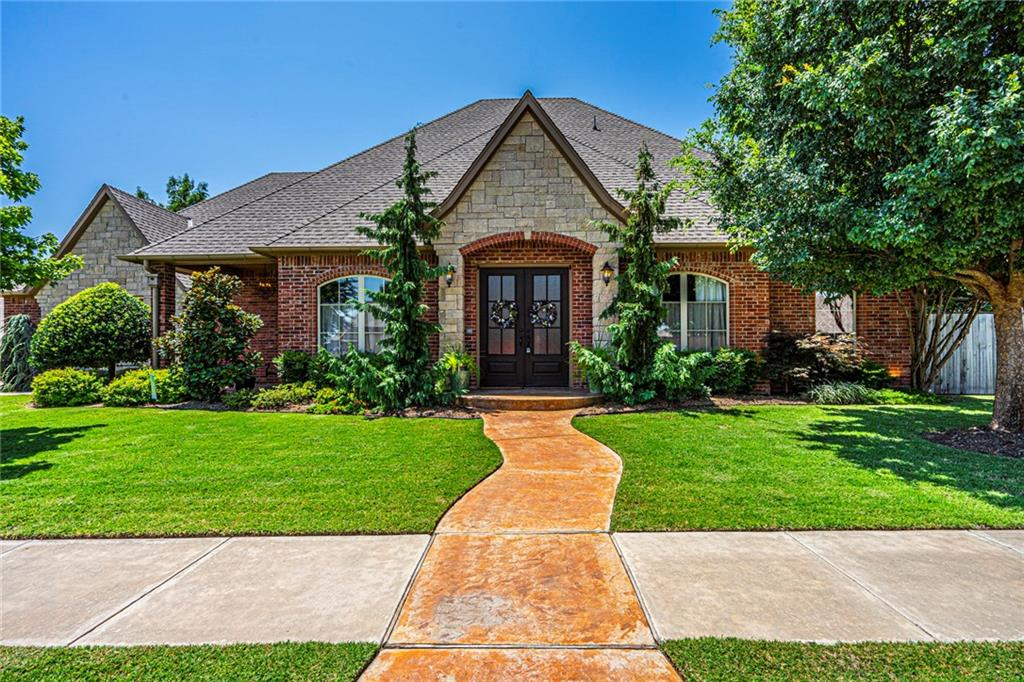 """Must see one of a kind show home. This French country's beauty has all the extras as a former Parade of Home. Unique wood stains and knotty alder throughout the entire house. Located in the much-desired neighborhood  """"The Willows """" with two large ponds, walking trails, and two gated entrances. Oversized three-car garage on a corner lot, spectacular landscaping, and a welcoming side entry porch. Open floor plan with a double-sided fireplace, large banquette that seats 8, in a spacious kitchen with double ovens and plenty of room to entertain. A beautiful bar that leads into the formal dining room. Large Master bedroom with incredible master bath, including jetted corner tub, double vanity with copper sinks. Must see the office with one of a kind knotty alder desk.  Upstairs is a family paradise with two bedrooms, large full bath with double vanities. Study area off the second living room that leads into a playroom/theater room. New 8ft privacy fence installed!"""