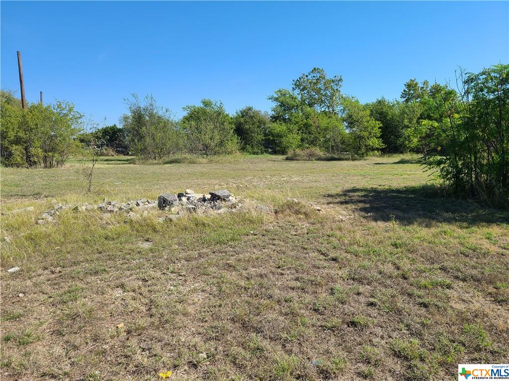 This property is seated on a 4.229 acreage with great potentials. Suitable for residential and commercial development. Excellent location on Hwy 95. Investors welcome