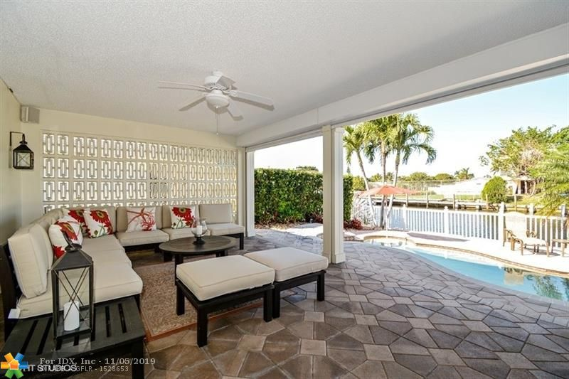 """THIS BEAUTIFUL WATERFRONT HOME IN THE EAST FT LAUDERDALE NEIGHBORHOOD OF THE LANDINGS IS THE PERFECT PLACE FOR YOU TO LIVE YOUR LUXURY LIFESTYLE! THE PROPERTY HAS LOTS OF FEATURES THAT WILL PAMPER YOU, INCLUDING LIVING AREAS WITH 24"""" SATURNIA MARBLE FLOORS & 10"""" CROWN MOLDINGS, A GOURMET KITCHEN WITH VIKING GAS RANGE, LAUNDRY ROOM WITH BOSCH WASHER & DRYER, OUTSIDE LIVING ROOM WITH HEATED POOL AND SPA, 80 FEET OF WATER FRONTAGE, WHOLE HOUSE GENERATOR, IMPACT RESISTANT WINDOWS & DOORS AND MORE!"""