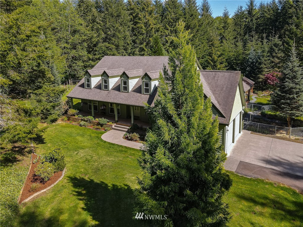 """On one of the prettiest & most popular roads in the County, sits this 14+ acre estate. A gated, long private drive through trees, leads to a 3,700+ sq. ft., custom built home. Privacy, peace & quiet.  Large, 2 car attached garage w/space for storage, freezer + refrigerator+. Separate 2 car 30 X 60' garage/shop. Green house + a large garden building with more inside parking. 1 1/2 acres of pasture, 5 acres of fir, 5 acres of alder.  Fruit trees, large garden area completely fenced for deer. Koi pond, water feature. Living rm w/vaulted ceilings & beautiful solarium/sun rm. 3 bdrms, 2 1/2 baths. Upstairs, 3  newly finished rooms could easily make a 4th or 5th bedroom. High speed internet. Wired for generator. 5 minutes to a """"bottle of milk."""""""