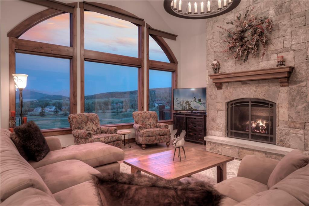 This warm Great Room greets yours you enter. The views to the east of Gyot, Baldy, Keystone and Independence  peak takes your breath away