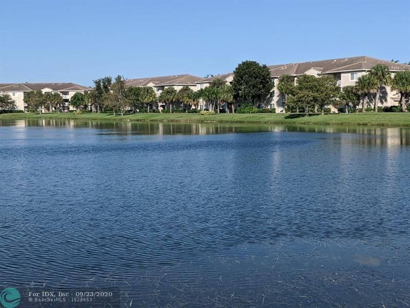 Welcome home to the gated community of Evergreen Lakes, which features a pool, gym, tennis courts and a path around the 16 acre lake! Located on the third floor is this well maintained condo. The living and dining rooms have vaulted ceilings. Enjoy views of the lake from inside or your private balcony. Bedrooms are conveniently located on either side of the living space, plus there is a washer and dryer in the unit. Pet friendly and can be rented twice per year. The Promenade at Coconut Creek is within walking distance.