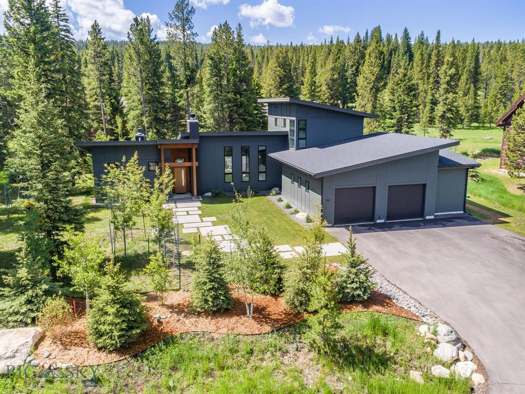 Stunning contemporary in beautiful Aspen Groves. Built by Greene Construction in 2015 for current owners. Large 0.76 acre lot at end of cul-de-sac provides elbow room and privacy. Groomed XC ski trail adjacent. Main level master plus main level living, dining, kitchen, pantry make this home ultimately livable. Also on the main level are a guest room with ensuite bath, powder room, mud room, large garage, exercise room with its own mini garage door and an outdoor living area that includes a wood burning fireplace, hot tub and even a TV! On the upper level, there is a bedroom with views of Lone Mountain and a large office that could be used as a 4th bedroom with views of Yellow Mountain. The upper level has one full bath. All tile, flooring, fixtures, etc. are top quality from Earth Elements: Bosch appliances, including an induction stovetop, solid quartz counters throughout the home. Beautiful landscaping. Only 2 miles from Town Center and 7.5 miles to the ski lifts at Big Sky Resort.