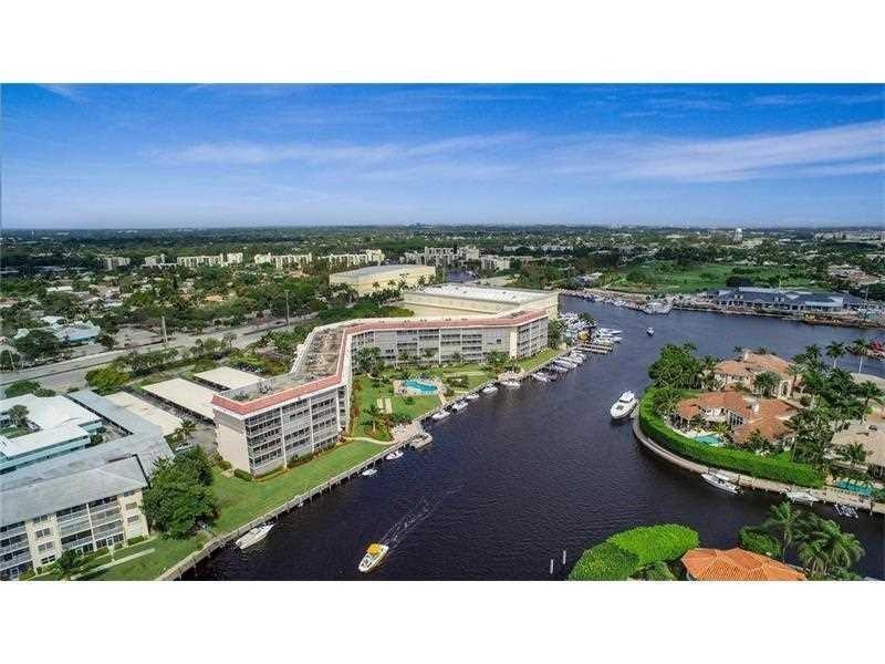 Spectacular Waterfront Luxurious Contemporary Condo! Totally remodeled with high end finishes, Furniture included in the Sale! Make this a Vacation Home or enjoy it all yr around!! Very well located, near Restaurants, Stores, Shoppes! Close to the Famous Deerfield Beach and to Mizner Park/Boca Raton! This Beautiful 1/1 Condo features Ceramic Tile throughout,  an Open Kitchen with Wood Cabinets and Corian Counter Tops, Luxury Stainless Steel Appliances Sub-Zero, Bertazzoni, Gaggenau Refrigerator, Stove, Microwave, Dishwasher and Wine Cooler. Spacious Bedroom with Large Walk in Closet, California Closets. Bathroom with Tub and Shower. Enjoy the peaceful Water view from everywhere! Relax in the large Screened in Balcony. Hurricane Impact Windows & Sliding Doors. Beautiful Pool Area & Dockage.